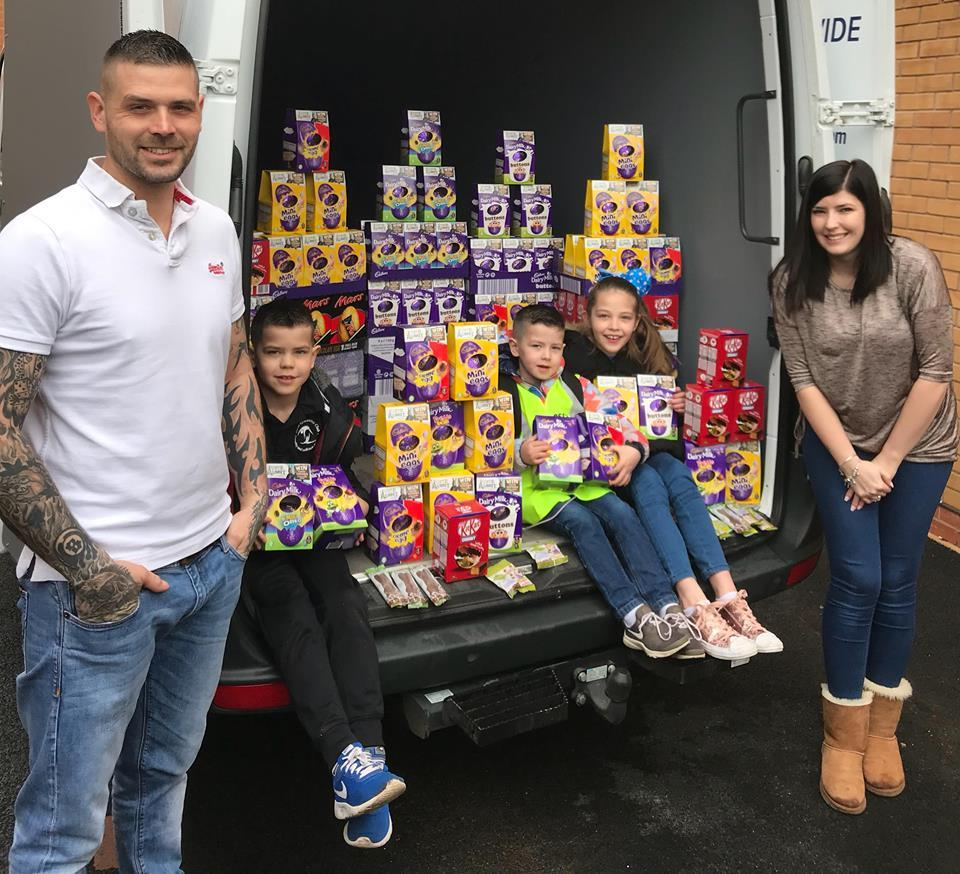 The Hughes family with some of the donations.
