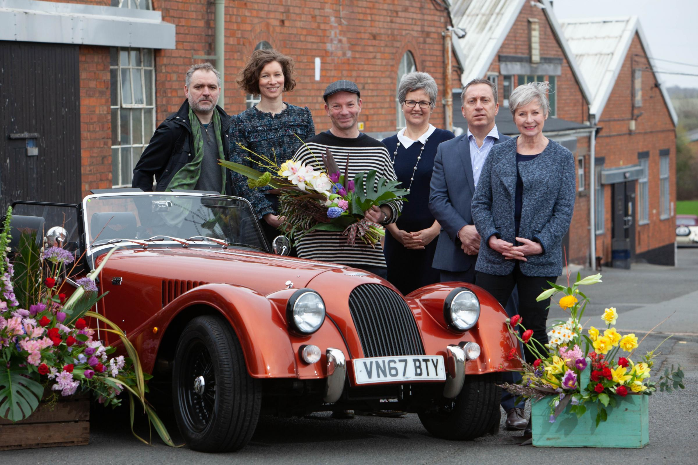 SPECTACULAR: Floral designer Jonathan Moseley (in front) with Nick and Julia Davies from the Cottage in the Wood, Diana Walton of RHS Malvern, Morgan Motor Company Managing Director Steven Morgan and Museum of Royal Worcester Managing Director Amanda Savi