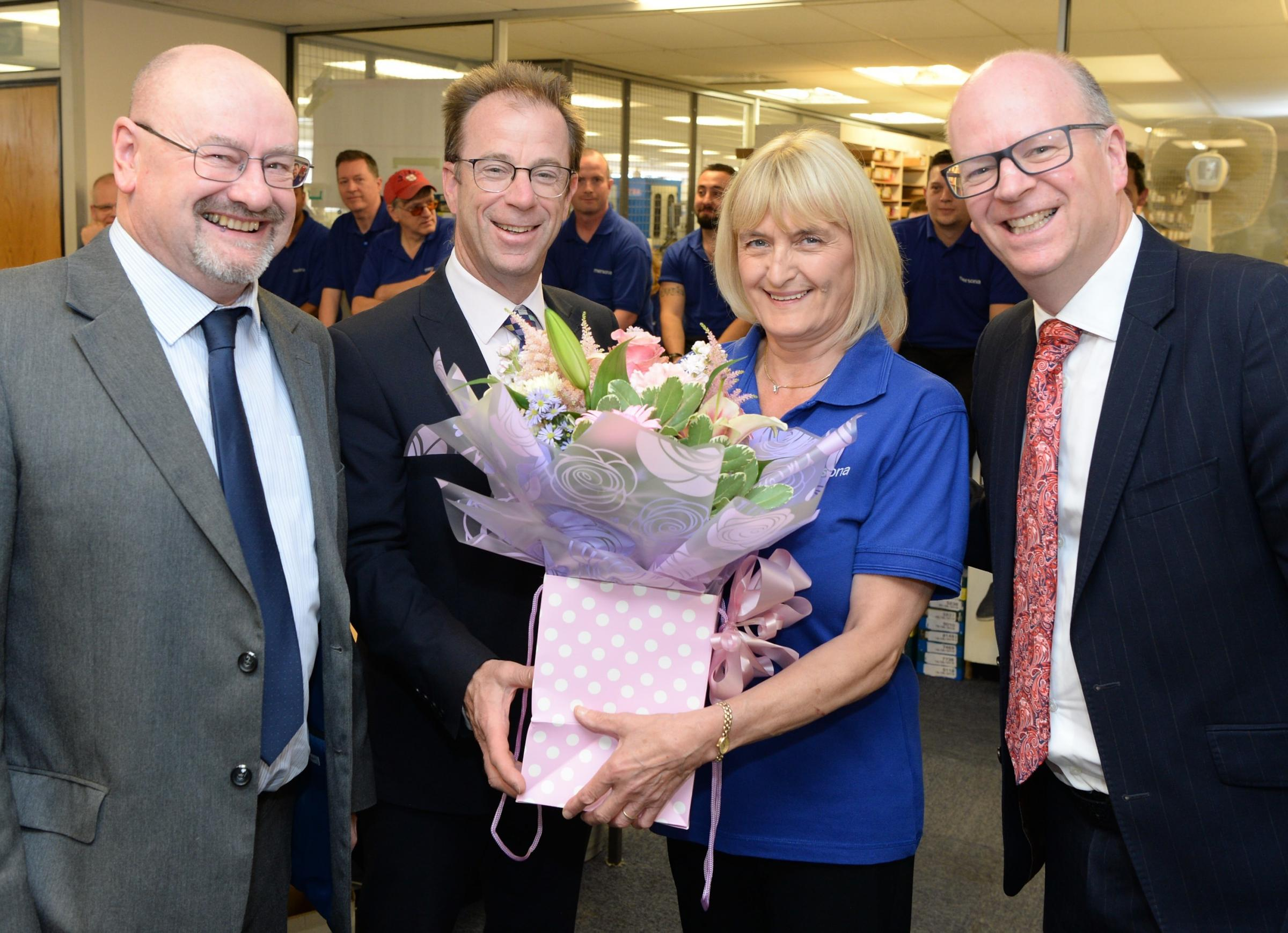 Chris Keeley celebrates 40 years of loyal service to Halesowen opticians Scrivens, alongside Gary Davies, Nicholas Georgevic and Mark Georgevic.