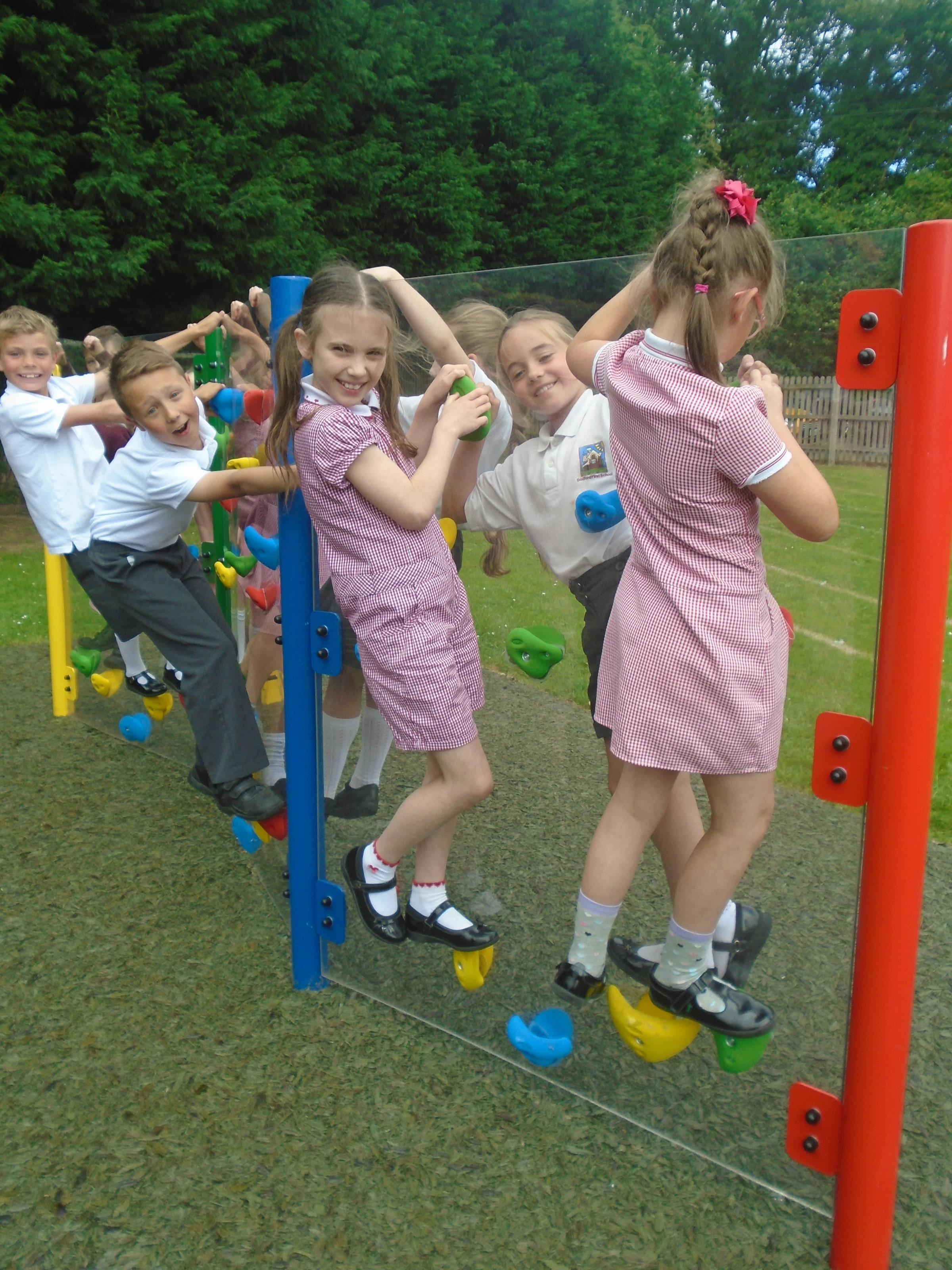 Year 4 children using the climbing wall