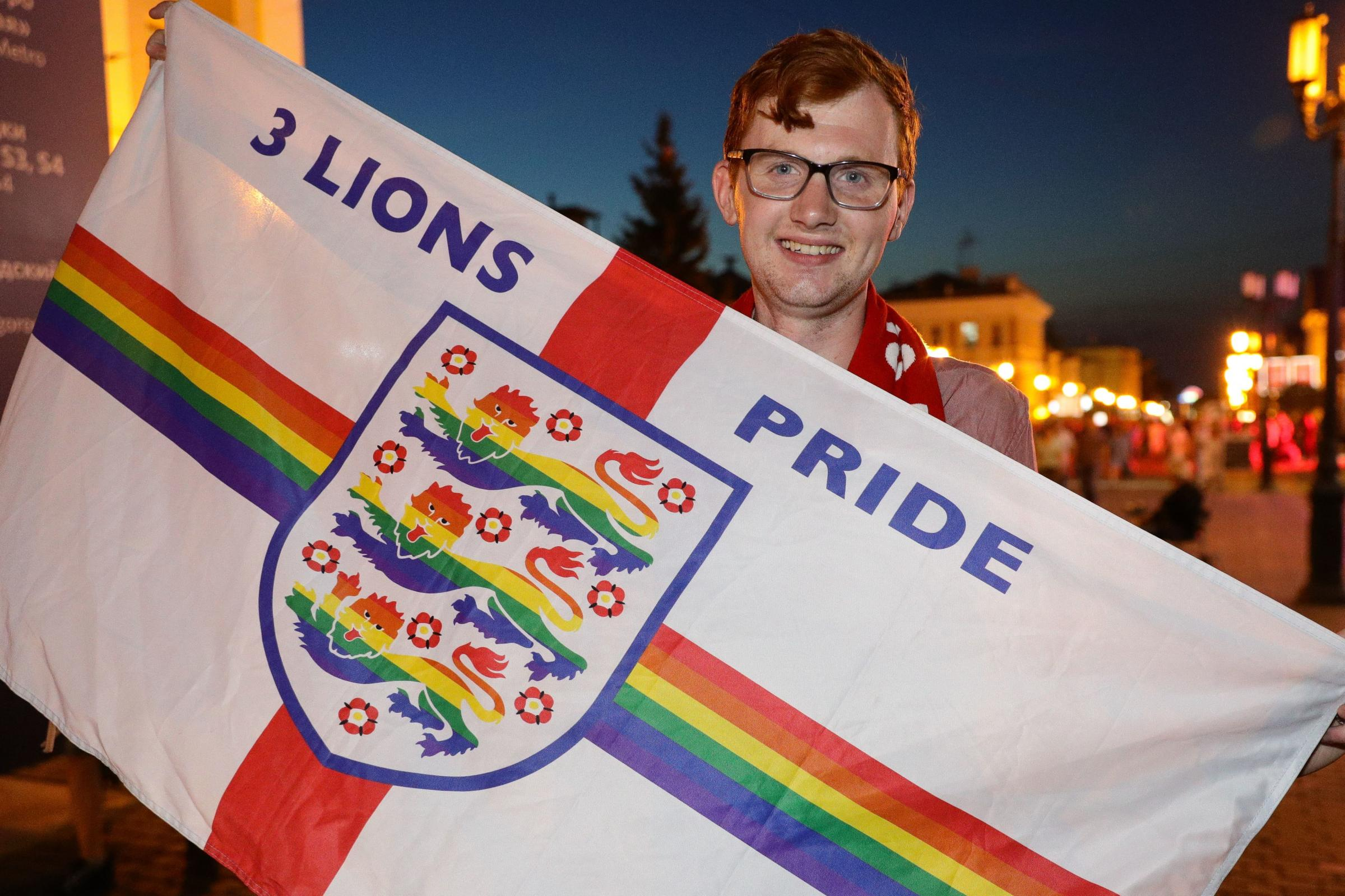 Joe White holds his Three Lions Pride flag in the central street of Nizhny Novgorod, Russia