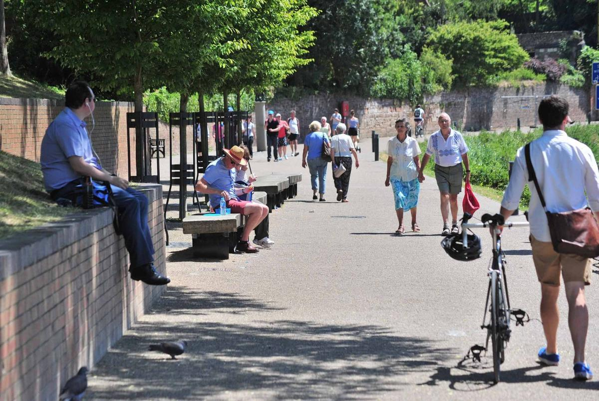 People enjoying the hot weather on South Quay, Worcester. Photo by Jonathan Barry