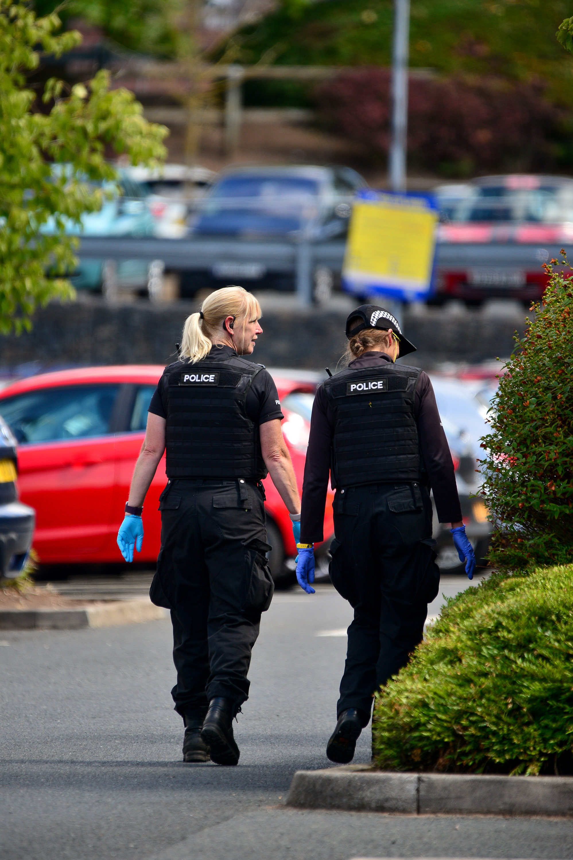 Police officers conducting a search of Shrub Hill Retail Park in Worcester where police are investigating a suspected acid attack on a 3-year-old child which happened in the store on Saturday (21/7).   See News Team story NTIACID; Police have released thi