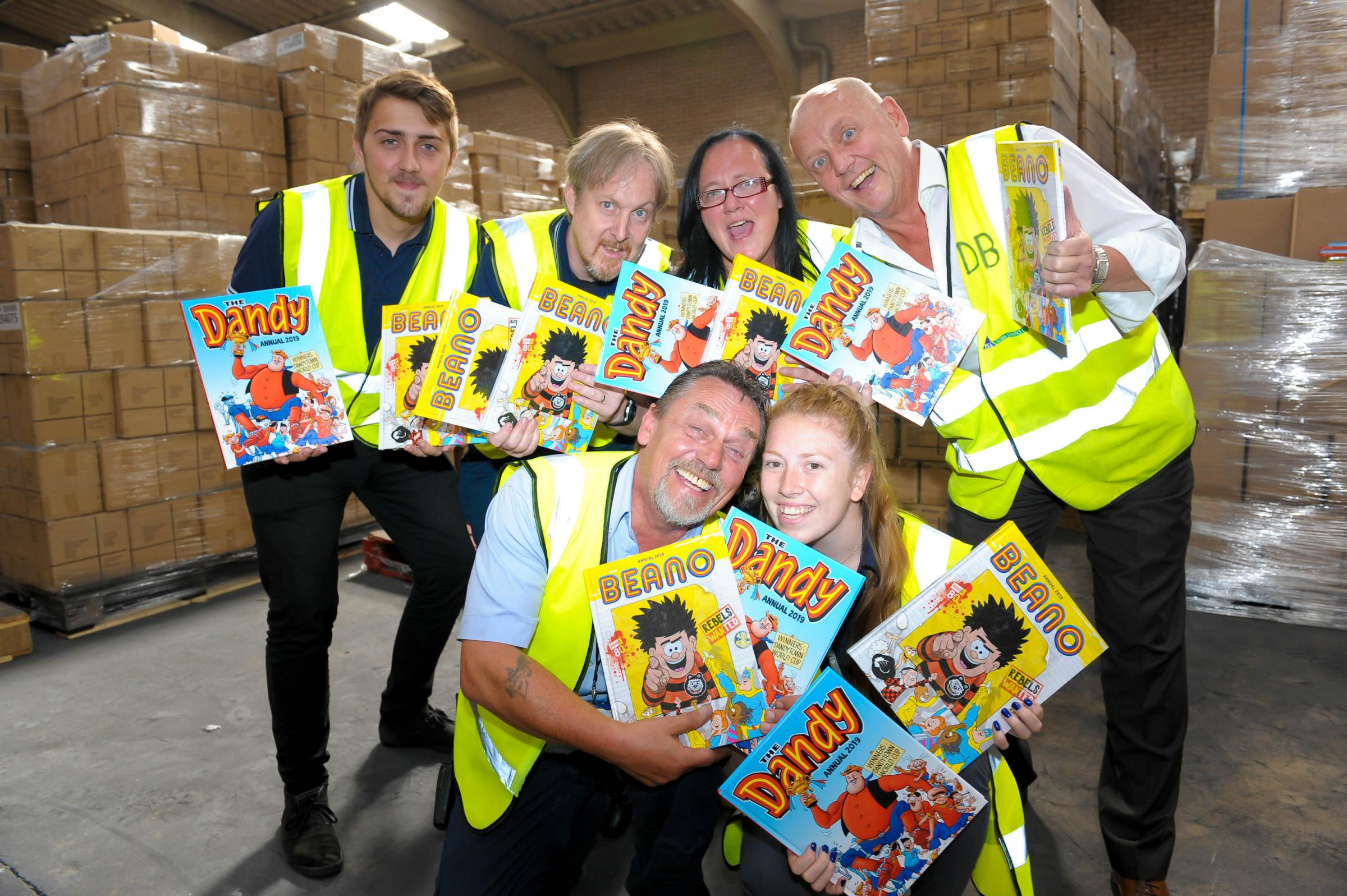 The PGS Global Logistics team with the Beano and Dandy albums.