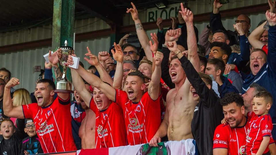 Sporting's players celebrate play-off success. Photo courtesy of Bromsgrove Sporting
